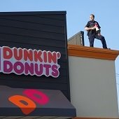Cop on Dunkin Roof